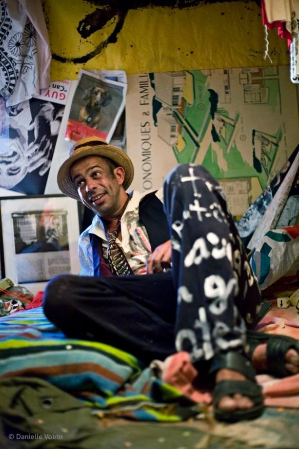 Suisse inside his installation at the Vagabond Gallery show in a store-front space on rue des Saint Pères.  Paris, 2009.