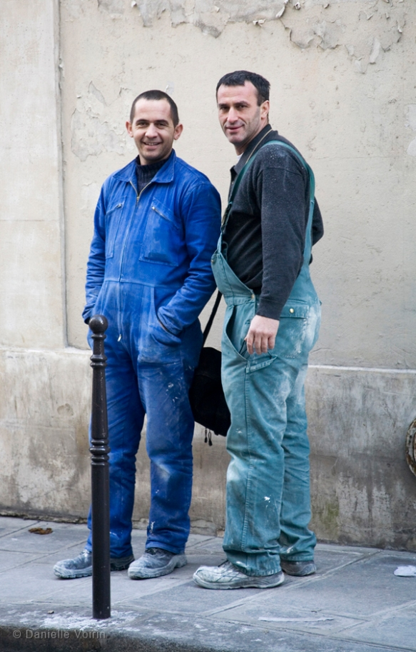 Two workers on the rue Charlot.